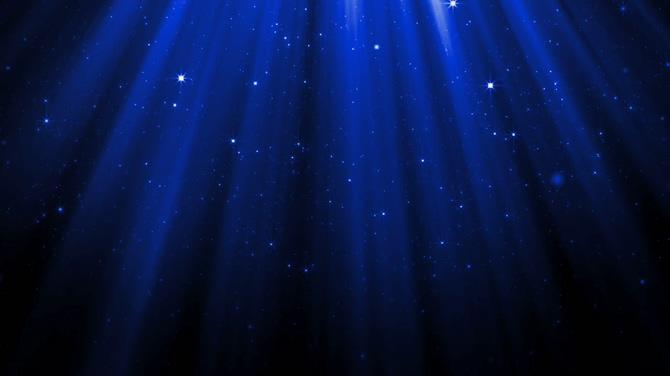 浪漫唯美的蓝色灯光照射下粒子飘落的视频素材