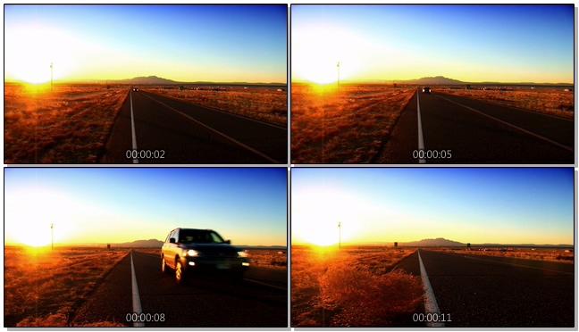 浪漫黄昏下汽车行驶在无人公路的实拍视频