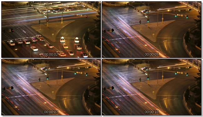 高清拍摄城市夜晚十字路口人流移动的实拍视频