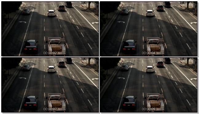 从远处拍摄汽车在十字路口等待的实拍视频