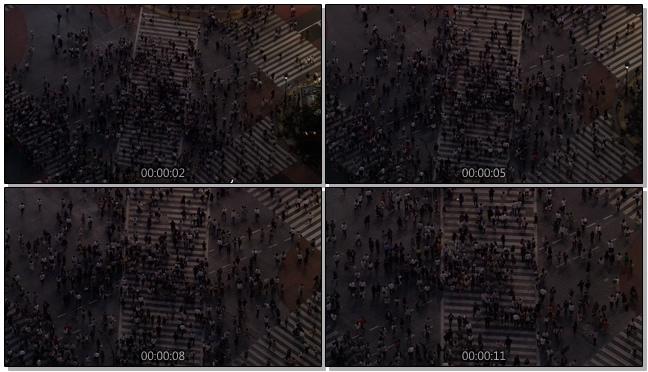 从上空拍摄城市十字路口人潮拥挤的实拍视频