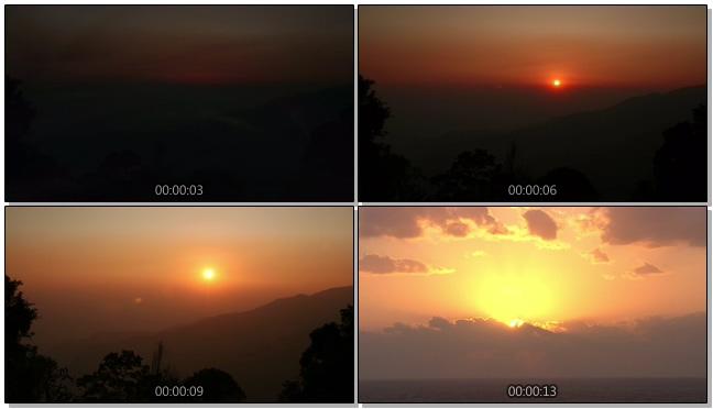 从远处拍摄梦幻日出过程的实拍视频