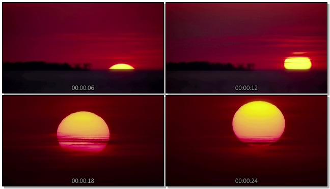 火红的太阳缓慢升起的实拍视频