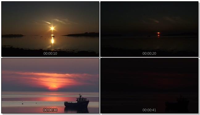 平静的海面上见证日落过程的实拍视频