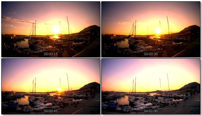 浪漫唯美的日落照射在渔船上的实拍视频