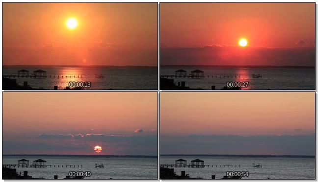 唯美梦幻的火红太阳在海平线上落下的实拍视频