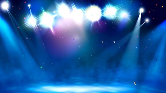舞台灯光照射下彩色粒子飘落的视频素材