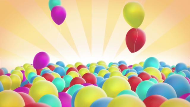 五彩斑斓的气球飞上天空的背景视频