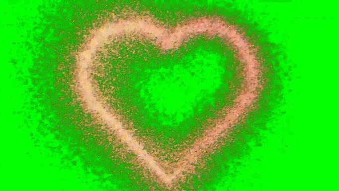 小粒子形成浪漫爱心的背景视频