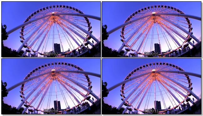 幸福摩天轮旋转时灯光闪烁的实拍视频